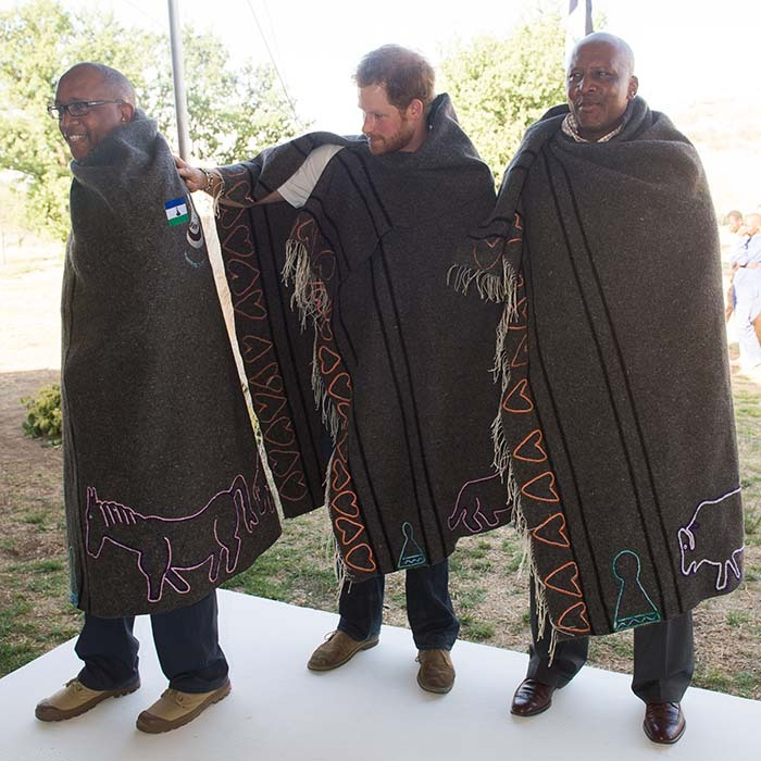 <p>Prince Seeiso, Prince Harry and King Letsie III were given custom-made shawls at the opening ceremony.</p>
