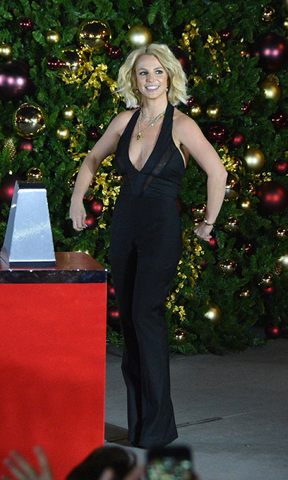 <p> Britney Spears gets ready to rock around the Christmas tree at a special tree-lighting ceremony at the LINQ Promenade in Las Vegas.</p>