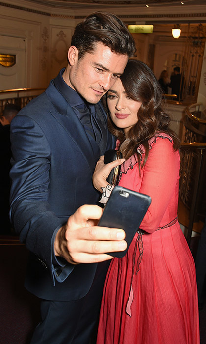 <p> Orlando Bloom and Salma Hayek take one beautiful selfie together at the British Fashion Awards in London.</p>