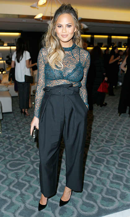 <p> The former <em>Sports Illustrated</em> model dares to go bare in a sexy lace Femme d'Armes top with high-waisted Stella McCartney slacks at <em>The Hollywood Reporter</em>'s Beauty Issue party.</p>