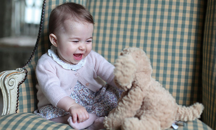 <p> Seven-month-old Princess Charlotte shares a giggle with her favourite stuffed toy in one of two new photos of the royal tot released by Prince William and Kate.</p>