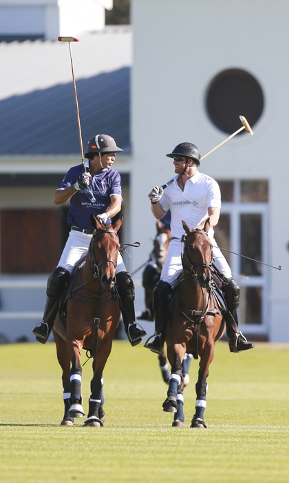 Prince Harry chats with Sentebale polo ambassador Nacho Figueras on the field during the Royal Salute Polo Cup in Paarl, South Africa. 