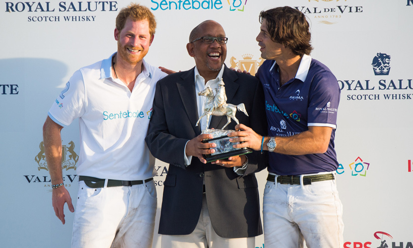 Prince Harry poses with his Sentebale co-founder Prince Seeiso of Lesotho and the charity's polo ambassador, Nacho Figueras, whose team own the first cup on African soil.