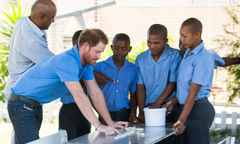Prince Harry was focused on the game at hand when he dropped in on the Ottery Youth Centre in Cape Town, which rehabilitates young people associated with gang-related crimes through education and athletics. 