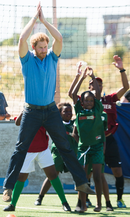Who said white men can't jump? Prince Harry gets some serious height while participating in football training with a group of young players at the Football For Hope Centre in Khayelistsha on Nov. 30. 