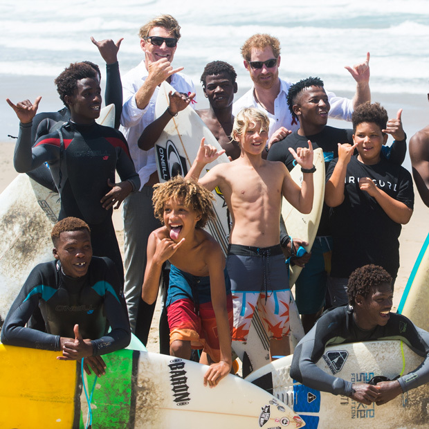 Surf's up! South Africa is famous for surfing, and Prince Harry got in on the action watching demonstrations  by kids benefitting from the charity Surfers Not Street Children in Durban.