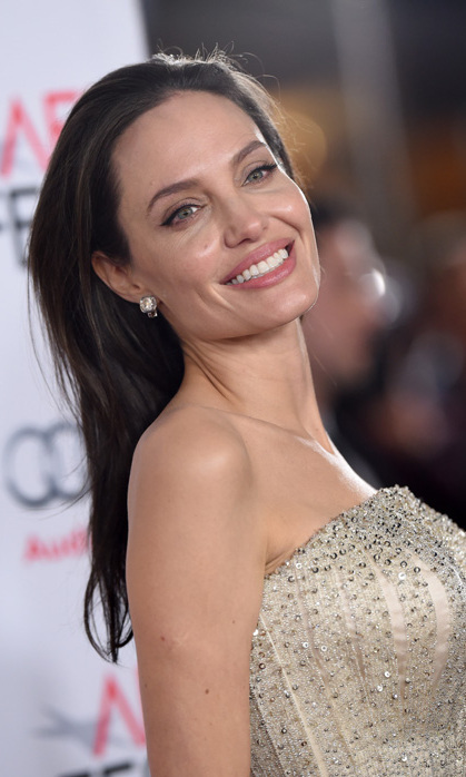"<p> After undergoing preventative cancer surgeries in her 30s, mother of six Angelina Jolie is grateful to be 40 and healthy. ""I feel grounded as a woman. My mother and my grandmother started dying in their 40s. I'm 40. I can't wait to hit 50 and know I made it,"" she told <em>Vogue</em>.</p>