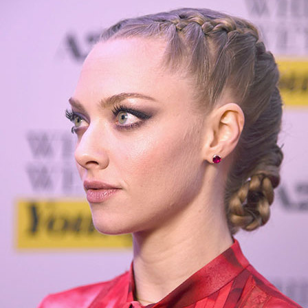 The <em>Mean Girls</em> star mixed French plaits and braids for an effortlessly cool twist on a classic low bun.