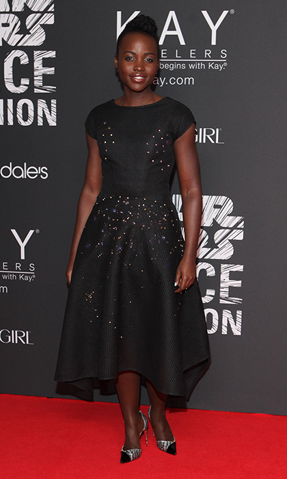Lupita Nyong'o donned a stellar Zac Posen dress with interstellar gold-flecked detailing for the 'Star Wars' Force 4 Fashion event in New York City. 