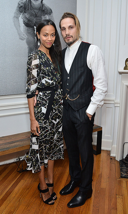 Zoe Saldana (with husband Marco Perego) is an artistic vision in a geometric-printed Preen dress for an arts event celebrating the work of Jared Lehr at The Talmadge in Los Angeles. 