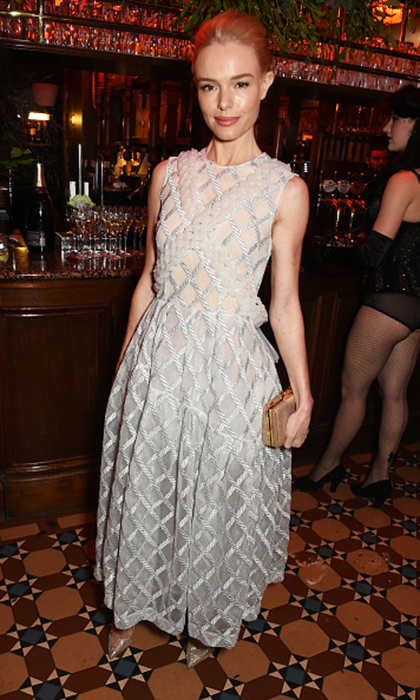 Kate Bosworth was chic and sweet in a lattice-embroidered Simone Rocha dress at Charlotte Tilbury's naughty Christmas party to fete the celebrity makeup artist's new flagship beauty boutique in London's Covent Garden.