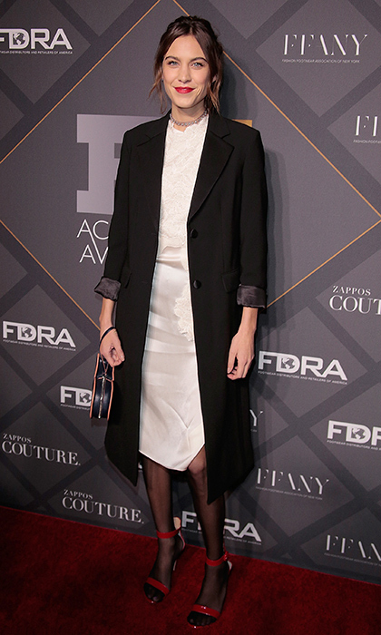 Alexa Chung adds a festive touch to her black-and-white Phillip Lim ensemble with red Gianvito Rossi single-strap heels at the FN Achievement Awards 2015 in New York City. 