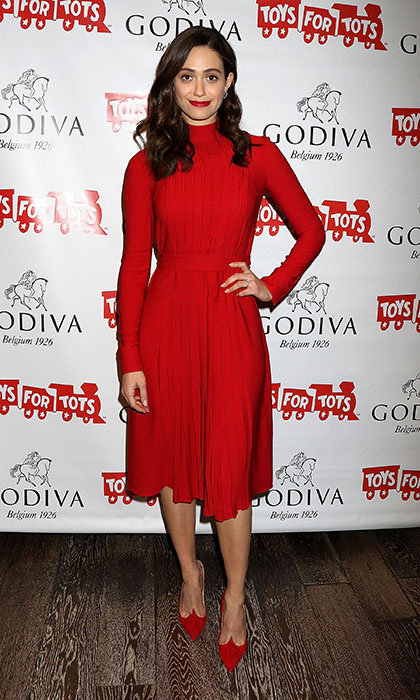 Rocking head-to-toe red (including a party-ready crimson lip), Emmy Rossum was radiant in a Salvatore Ferragamo turtleneck dress and matching Christian Louboutin 'Gwalior' pumps at Godiva's 'Hot Chocolate for a Cause' Event in New York City. 