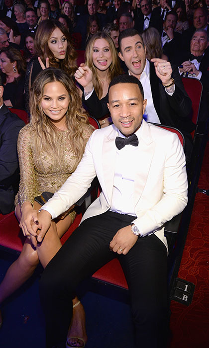 <p> While Chrissy Teigen and her husband John Legend pose for the perfect picture, pranksters Adam Levine, wife Behati Prinsloo and Katharine McPhee (L), get goofy behind their backs. The A-list crew invaded Las Vegas to attend the Sinatra 100: An All-Star GRAMMY Concert at the Wynn hotel.</p>