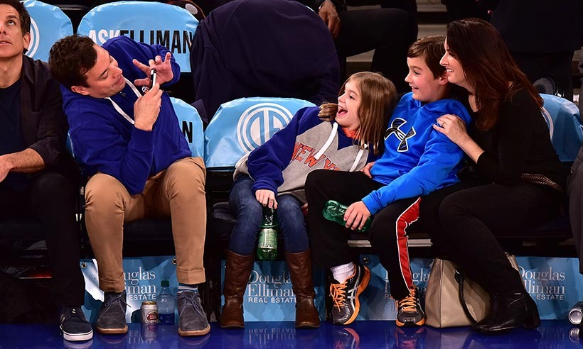 <p><i>Tonight Show</i> host Jimmy Fallon plays photographer for his sister, Gloria, and her kids at the New York Knicks home game on Dec. 2.</p>
