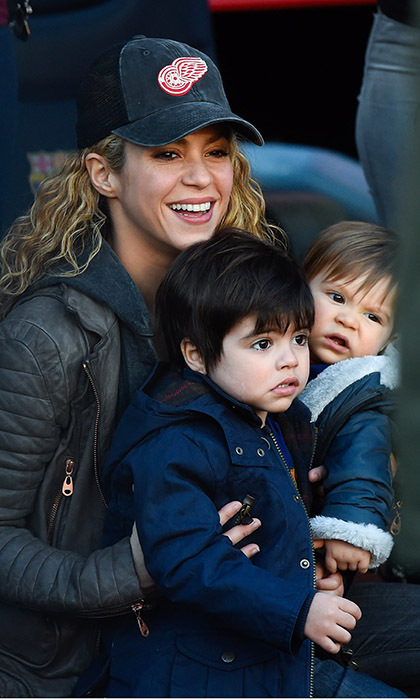 <p>Go daddy! Soccer star Gerard Pique's adorable sons, Milan, 2, and 10-month-old Sasha cheer on their dad with mom Shakira at the FC Barcelona and Real Sociedad game in Barcelona.</p>