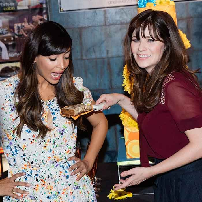 <p> Let them eat cake! Zooey Deschanel and Canadian actress Hannah Simone take a bite out of the celebration at the 100th episode cake cutting party for their hit show <i>New Girl</i>.</p> Photo: © Getty Images