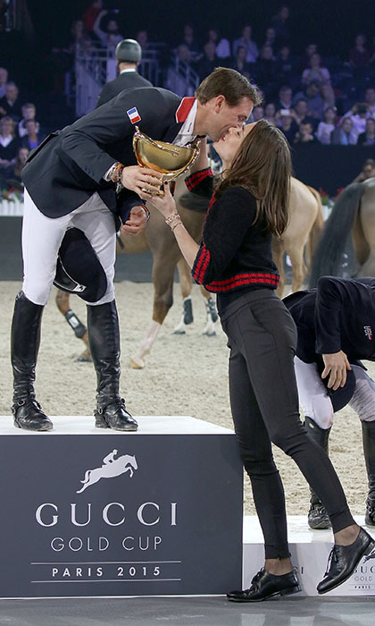 <p>Decorated equestrian Charlotte Casiraghi presents Simon Delestre with the Gucci Gold Cup at the Longines Paris Masters in Villepinte, France. </p>