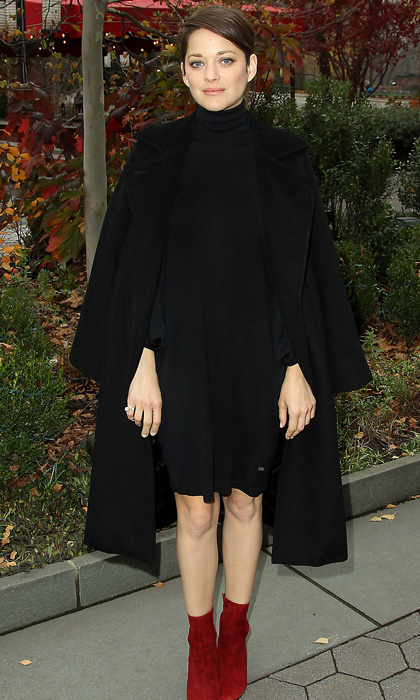 French actress Marion Cotillard added a pop of colour to her cozy black head-to-toe Dior ensemble with punchy red booties at the <em>Macbeth</em> luncheon in New York.