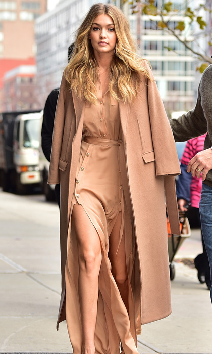 Gigi Hadid is casual and cool in a tone-on-tone Self-Portrait Militaire crepe maxi-dress with Topshop Unique wool coat draped over her shoulders as she moves about through New York City. 