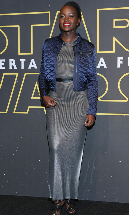Lupita Nyong'o casually paired her metallic Louis Vuitton evening dress with a cropped blue bomber jacket for an effortless red-carpet look at the <em>Star Wars: The Force Awakens</em> premi&egrave;re in Mexico City. 