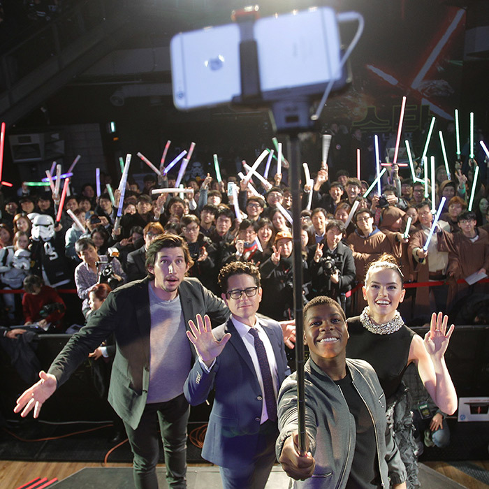 <p> The selfie force was with the cast and crew of <i>Star Wars</i> (from left: Adam Driver, director J.J. Abrams, John Boyega and Daisy Ridley) during a fan event in South Korea.</p>