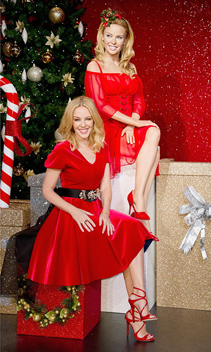 <p>Kylie Minogue strikes a pose next to her wax figure at Madame Tussauds in London.</p>