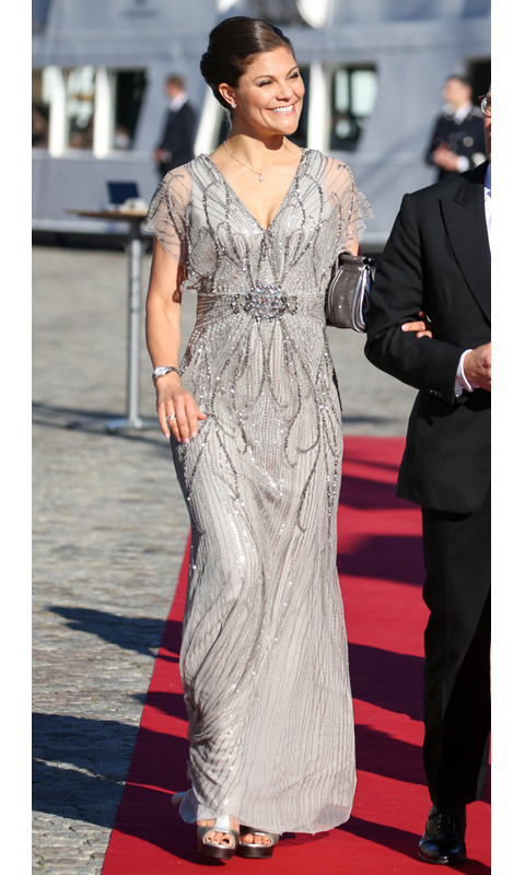 Crown Princess Victoria of Sweden took her black-tie inspiration from dazzling tinsel as she stepped out for teh pre-wedding dinner of her brother, Prince Carl Philip, and his now-wife Princess Sofia. She anchored the look with platform silver sandals and swept her hair into an elegant updo.