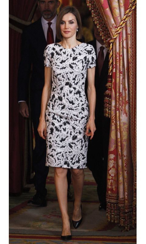 Try trading your red, silver or gold for a festive black-and-white number, like Queen Letizia of Spain's pretty shift dress. The monarch wore this polished look to receive the president of Paraguay.