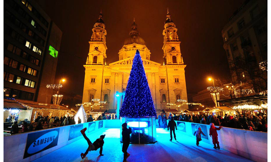 A Christmas tree is lit up in front of the Basilica of St. Stephen in Budapest, Hungary.