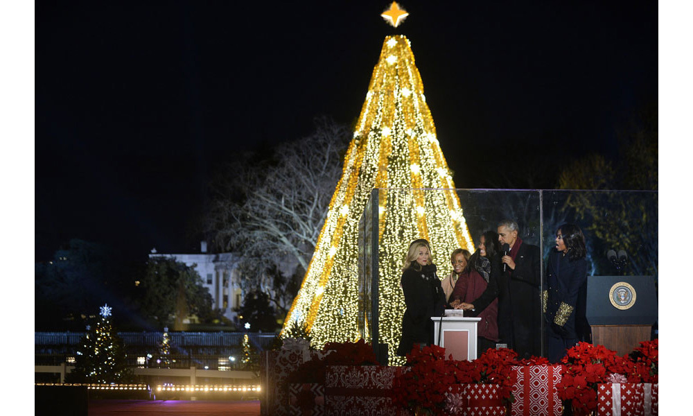 The Obama family, including Michelle's mother, Marian Robinson, and actress Reese Witherspoon officiate at the tree-lighting ceremony in Washington.