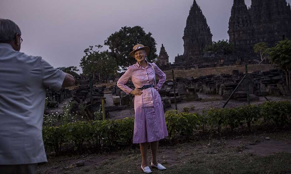 <p>Queen Margrethe of Denmark struck a pose for husband, Prince Henrik, during their visit to the Prambanan Temple in Indonesia.</p>