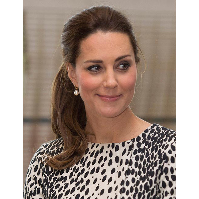 A few weeks before she welcomed Princess Charlotte into the world, Kate made quite the impression in the seaside town of Margate with her chic dalmatian-printed coat dress by Hobbs – and her stunning sleek ponytail was just as eye-catching. Not a hair was out of place in the royal's slicked back roots paired with the wavy ponytail.<br>
