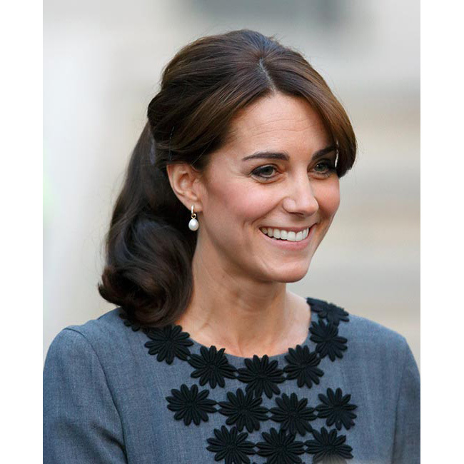 "<a href=""/tags/0/princess-charlotte/"">Princess Charlotte</a>'s mother gave fans around the world major hair inspiration when she met staff and children from charity Chance UK in Islington, highlighting her sleek fringe by wearing her glossy tresses swept back into a wavy high ponytail.<br>