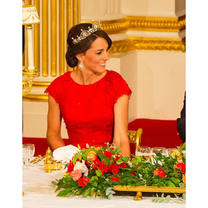 The Duchess looked every inch a style icon as she attended her first ever state banquet, her locks swept into an elegant chignon and accessorised with the glittering Lotus Flower tiara, which once belonged to the Queen Mother.<br>