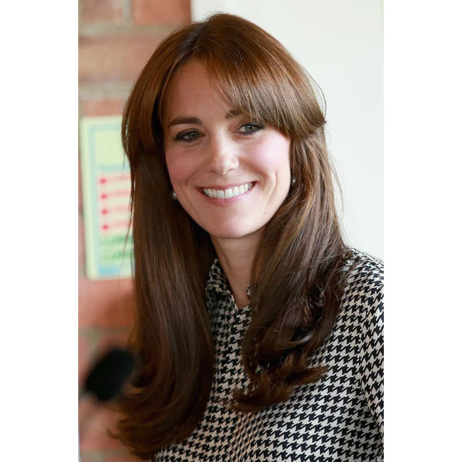 Making her first appearance after a brief maternity leave following the birth of Princess Charlotte, Kate debuted a striking fringed hairstyle as she paid a visit to the Anna Freud Centre, the rest of her hair worn down in her trademark blowdry style. The Duchess completed her look with a touch of eyeliner to complement her houndstooth ensemble.<br>