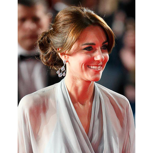 "Kate was simply dazzling as she joined <strong>Prince William</strong> and <a href=""/tags/0/prince-harry/"">Prince Harry</a> for the premiere of <em>Spectre</em> in October. For the glitzy event, the elegant royal chose to wear her glossy brunette locks swept up into an elegant chignon, pairing the style with striking dark smokey eye make-up for ultimate red carpet glamour.<br>