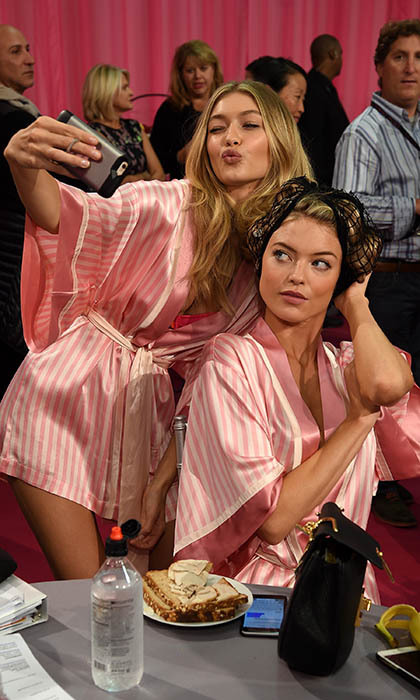 Let me take a selfie! Victoria's Secret models Gigi Hadid and Martha Hunt captured the excitement backstage at the lingerie brand's annual fashion show in New York. 