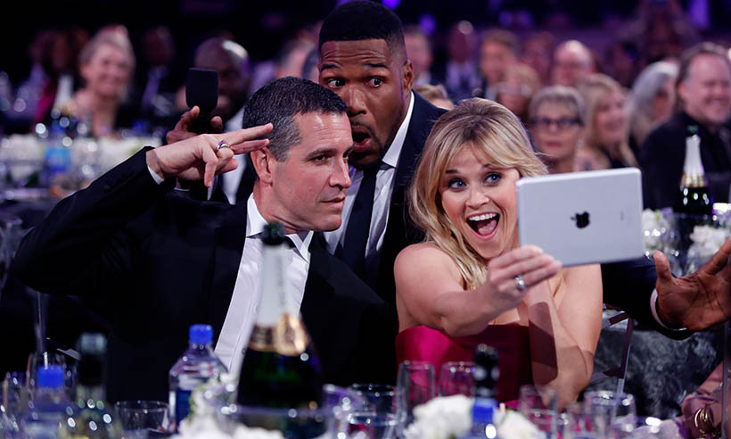 Morning talk show host Michael Strahan jumped at the chance to get in on a photo with Reese Witherspoon and her husband Jim Toth at the 20th Annual Critics' Choice Movie Awards in January. 