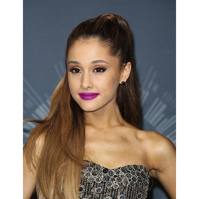 <strong>Ariana Grande</strong> opted for an edgy bright violet matte   shade as the VMAs, adding bronzed glittering eyeshadow and black winged   eyeliner for ultimate red carpet cool.