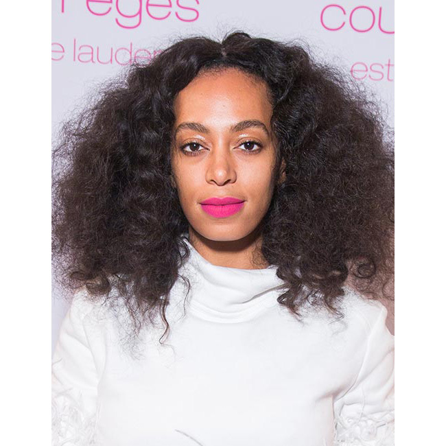 <strong>Solange Knowles</strong> showed off her chic beauty credentials with a neon pink shade, to perfectly offset her stylish white fluffy jacket and green patterned trousers.<br>