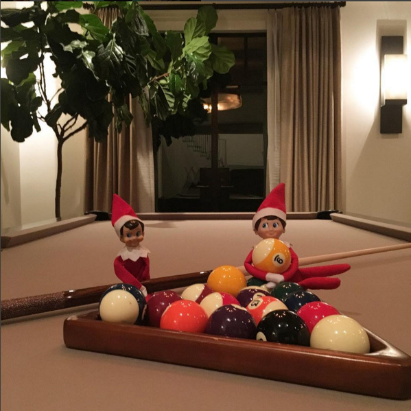 Kourtney Kardashian's elves decided that the best place to hang this season is the family pool table.