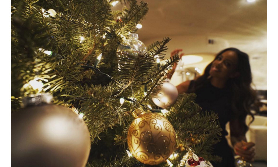 Kelly Rowland has been snapped decorating her tree. She also shared a close-up photo of one of her most precious decorations - a snow globe filled with presents.