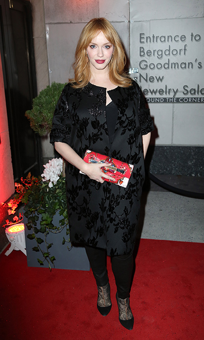 'Mad Men' star Christina Hendricks is holiday party ready in a brocade Amelia Toro coat, festive Rene Caovilla purse and sleek Valentino boots at the opening of Bergdorf Goodman's New Jewelry Salons in New York.