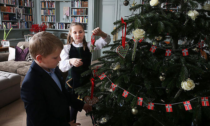 Princess Ingrid and Prince Sverre were captured putting the finishing touches to their beautiful Christmas tree.