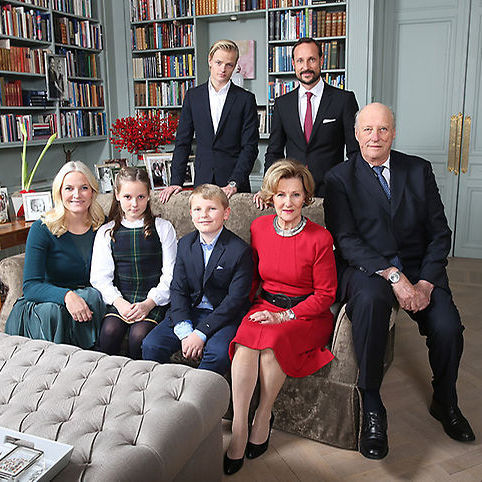 Another shot sees the majority of Norwegian family seated while Crown Prince Haakon stands next to his 18-year-old stepson, Marius Borg Høiby.