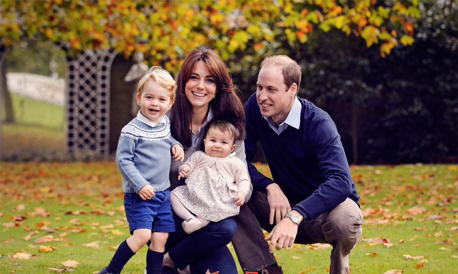 Prince William and Kate unveiled this adorable shot of their family in the gardens at Kensington Palace. Cutie Prince George looks as energetic as ever, while little Princess Charlotte sits smiling in her mother's lap.