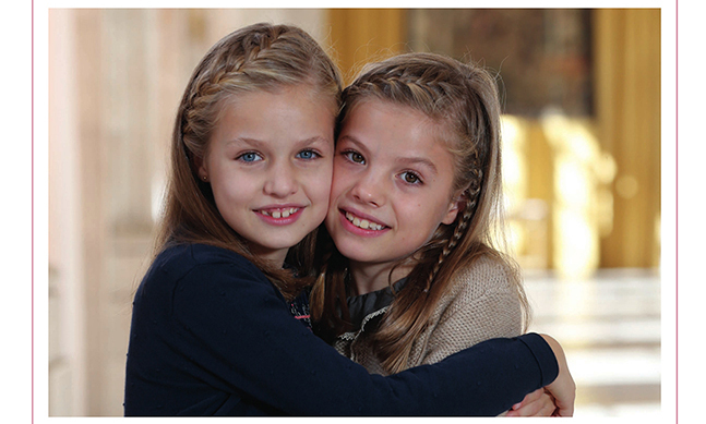 King Felipe VI and Queen Letizia of Spain's card features their gorgeous daughters, Princess Leonor, 10, and 8-year-old Princess Sofia.