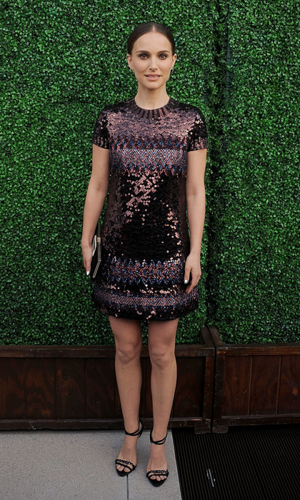 A simple t-shirt dress is anything but boring on Natalie Portman thanks to an intricate pattern of celebration-worthy burgundy sequins! 