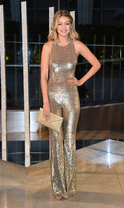 All that glitters is gold, and that's especially true on New Year's Eve! Gigi Hadid's custom Michael Kors jumpsuit for the CFDA Awards got the disco treatment thanks to its textured gold fabric. The blond beauty topped the look with a glittering envelope clutch.